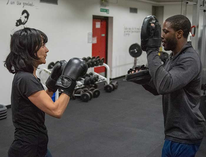 Babs with a personal training and boxing client at SW1 gym