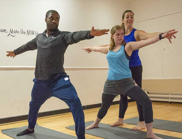 Yoga at SW1 Fitness with Babs instructing two female students
